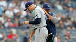 Manager Kevin Cash takes the ball from Blake Snell