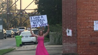 Louisiana man dons pink dress after losing football bet to wife