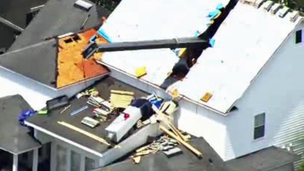 Crane topples over, splitting Orlando roof in half