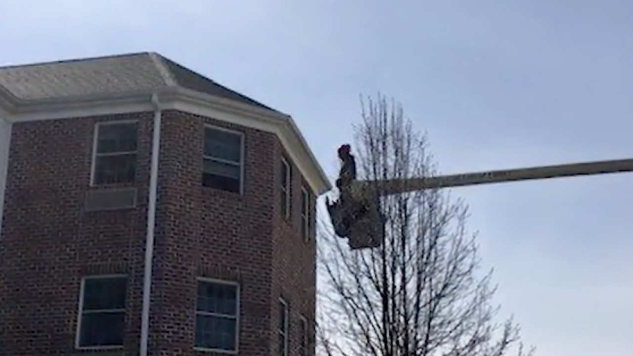Man uses bucket truck to visit mother on third floor of nursing home