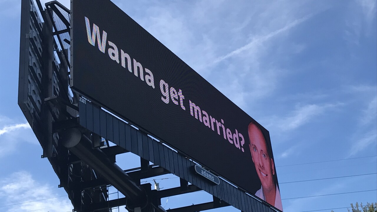 'Wanna get married?' billboard used as marketing, dating tactic for Virginia Beach realtor