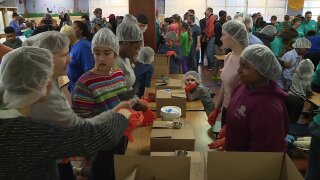 Volunteers 'working together' pack 10,000 meals for Richmondfamilies