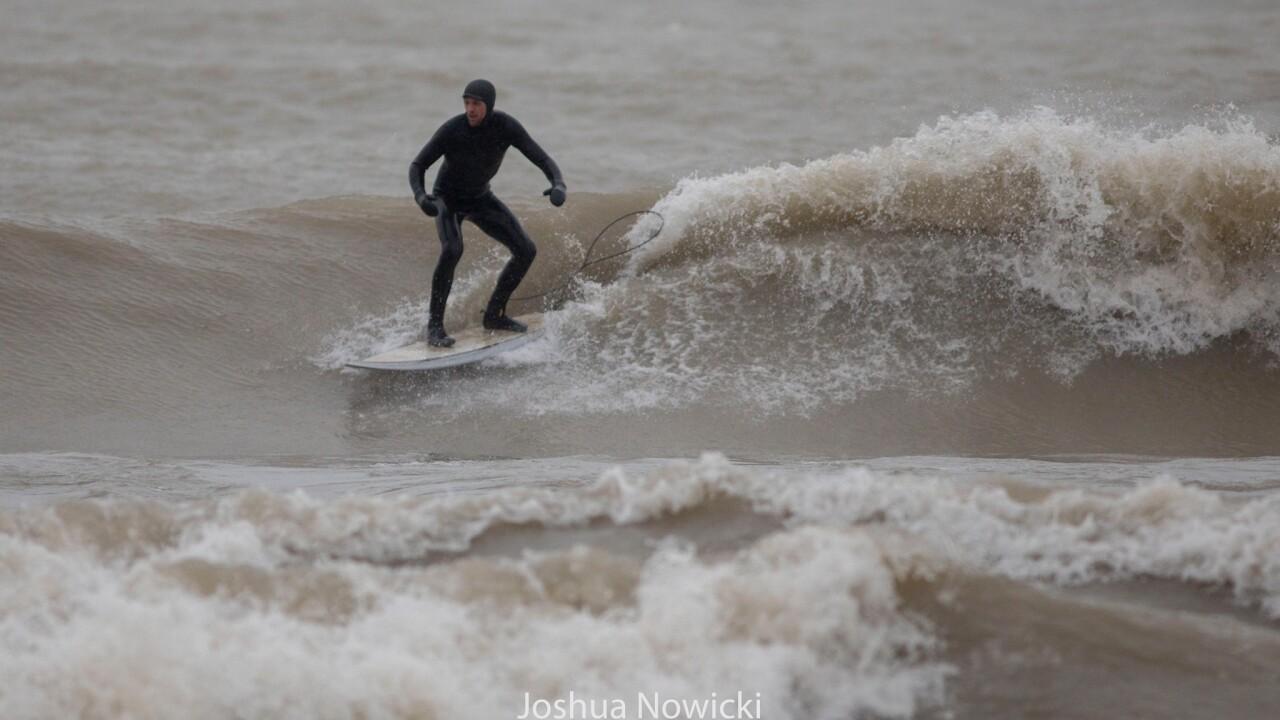 Surfers on Lake Michigan - Courtesy JOSHUA NOWICKI PHOTOGRAPHY