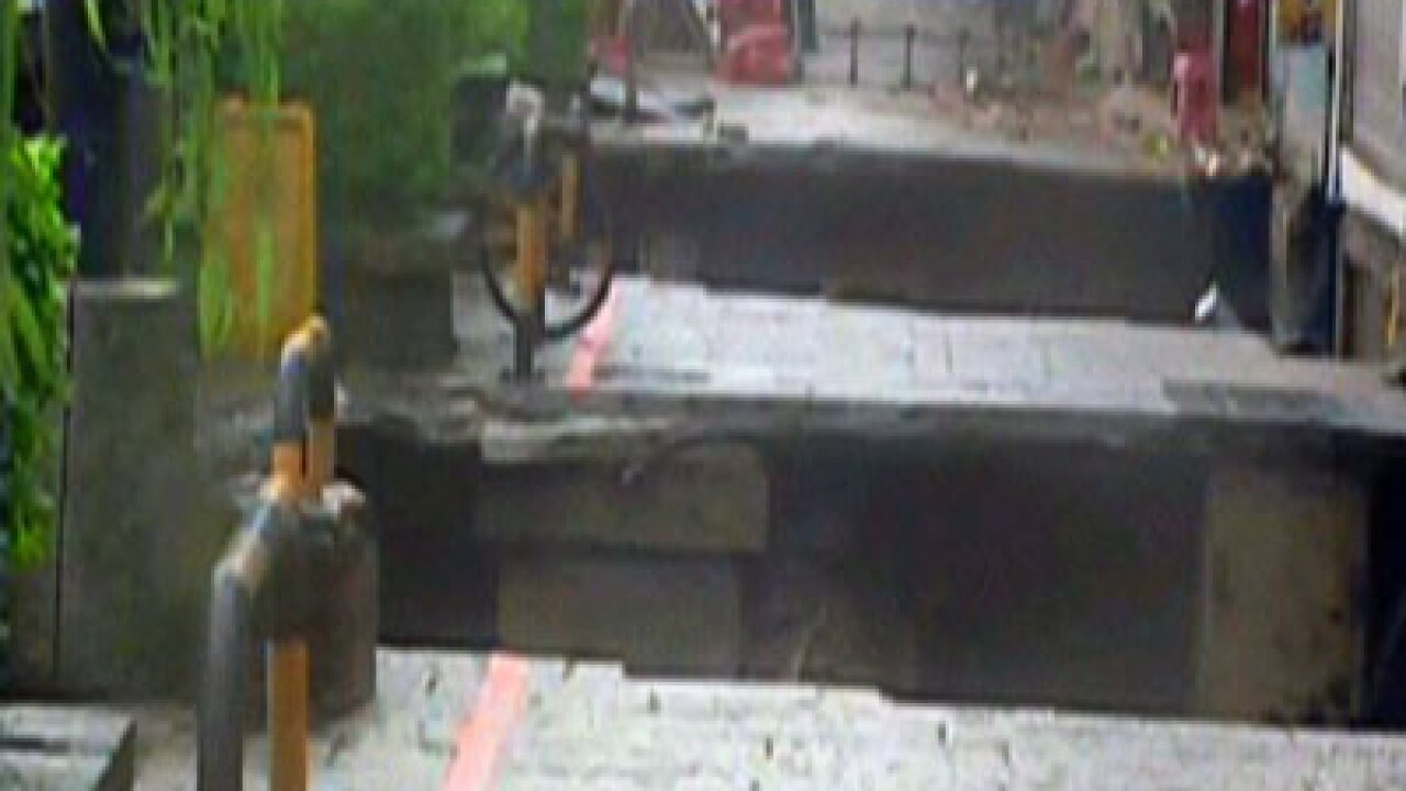 Raw Video: Man swallowed by huge sinkhole