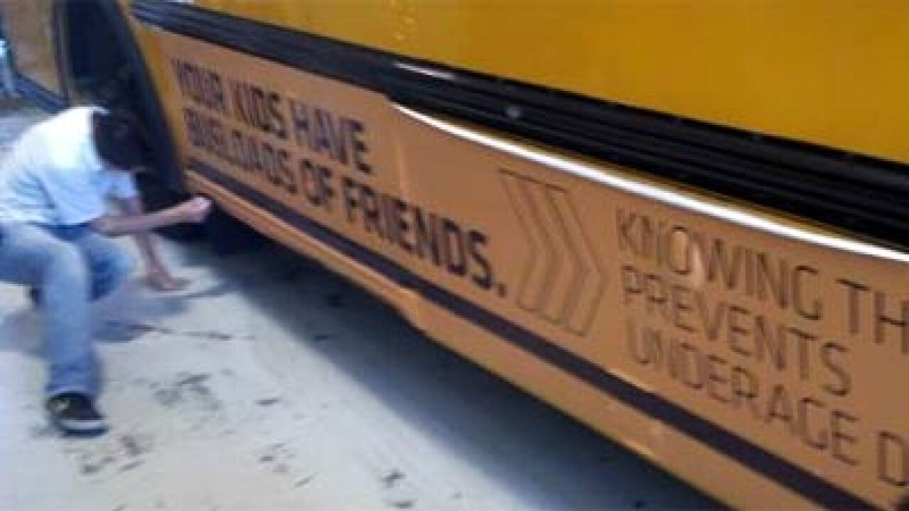Ads placed on four Jordan District school buses