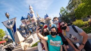 Guests Arrive at Sleeping Beauty Castle as Disneyland Park Reopens