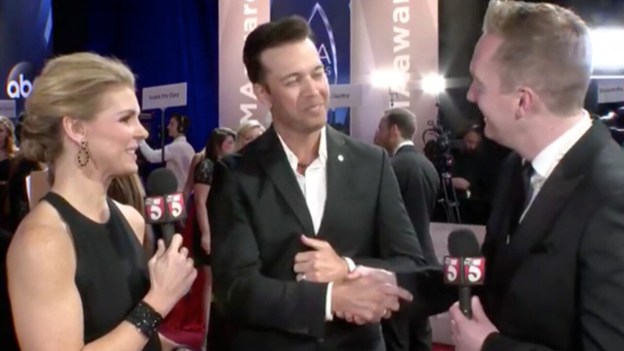 Country stars walk CMA Awards red carpet