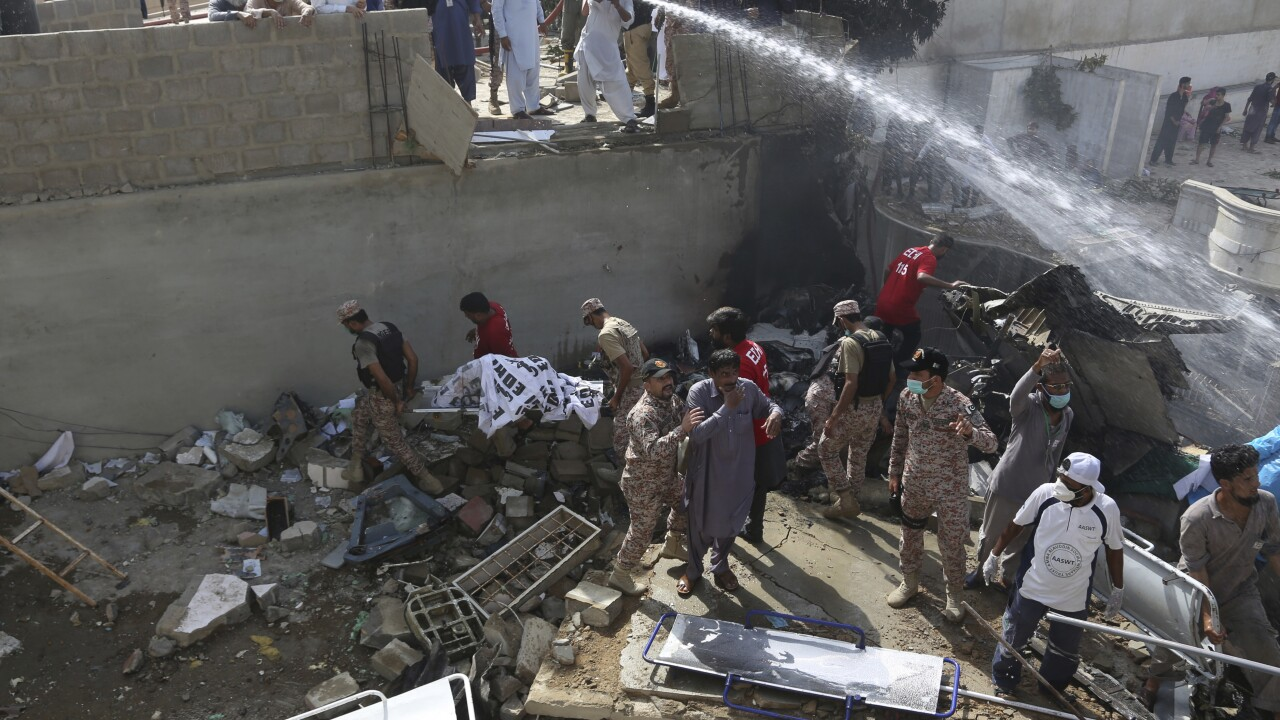 CORRECTION APTOPIX Pakistan Plane Crash