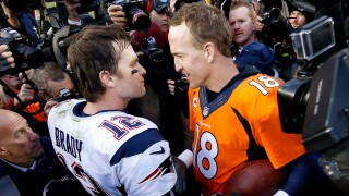 """In this Jan. 24, 2016, file photo, New England Patriots quarterback Tom Brady, left, and Denver Broncos quarterback Peyton Manning speak to one another following the AFC Championship game in Denver. The next match involving Tiger Woods and Phil Mickelson involves a $10 million donation for COVID-19 relief efforts, along with plenty of bragging rights in a star-powered foursome May 24 at Medalist Golf Club. Turner Sports announced more details Thursday, May 7, 2020, for """"The Match: Champions for Charity,"""" a televised match between Woods and Peyton Manning against Mickelson and Tom Brady."""