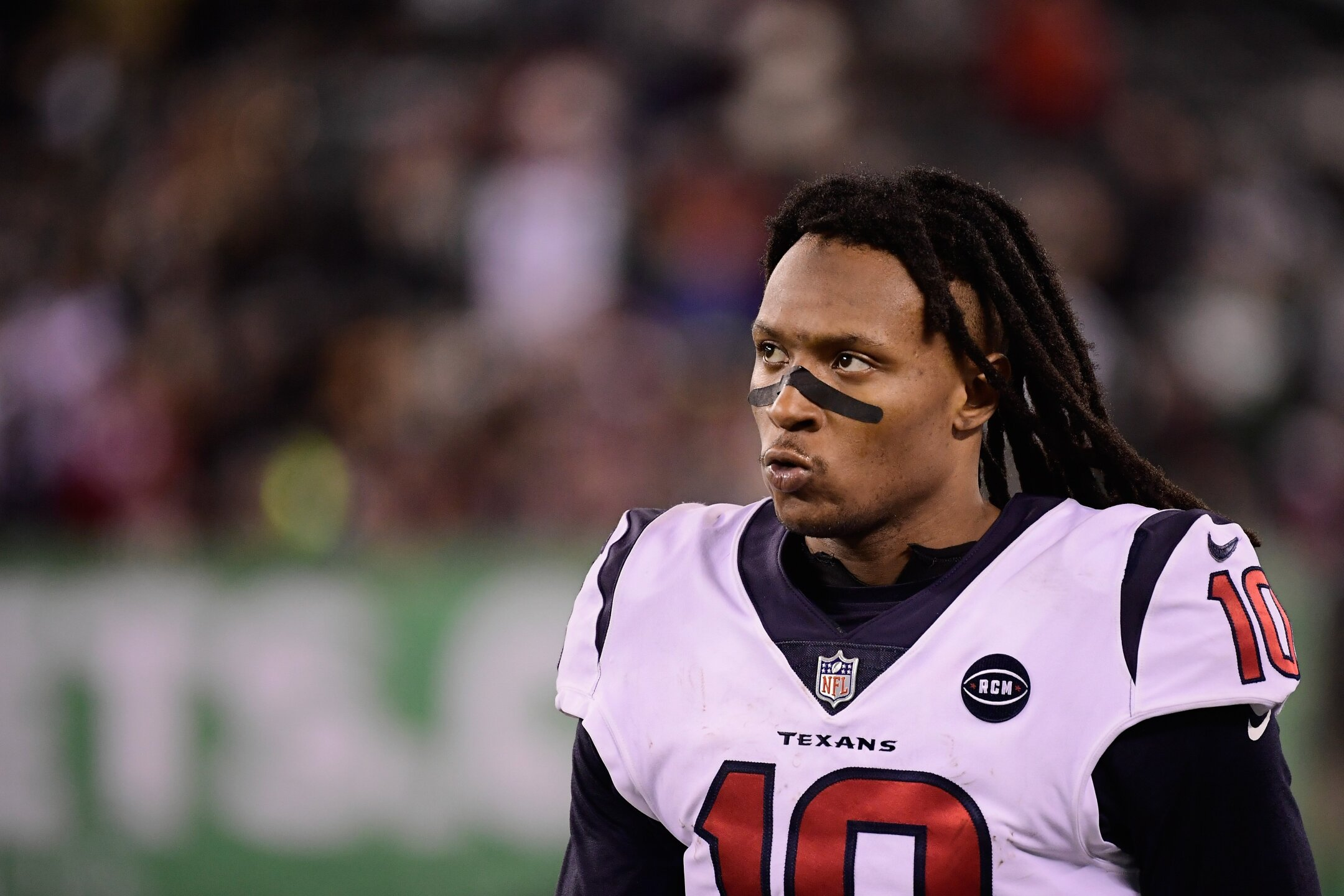 Photos: DeAndre Hopkins pledges playoff game check to family of 7-year-old murdered in Houston drive-by