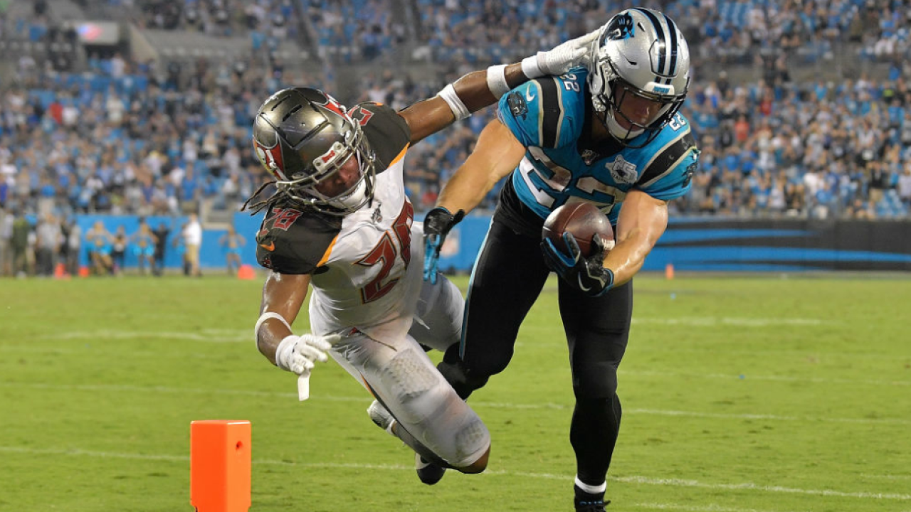 Vernon Hargreaves III tackles Christian McCaffrey