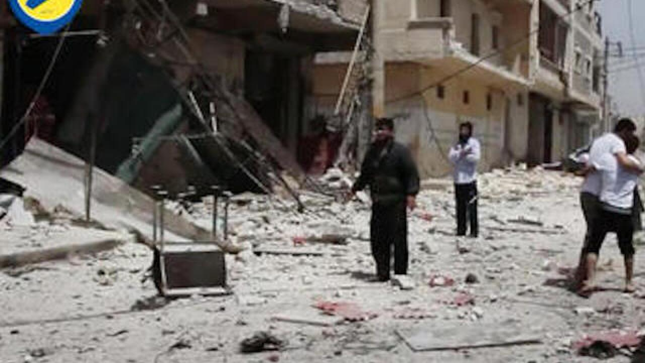 Airstrikes, shelling kill dozens in Syria