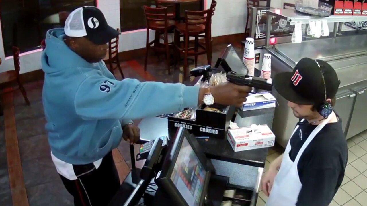 Gun to head, cashier icily hands overcash