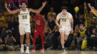 Michigan beats No. 25 Rutgers for 10th straight Garden win
