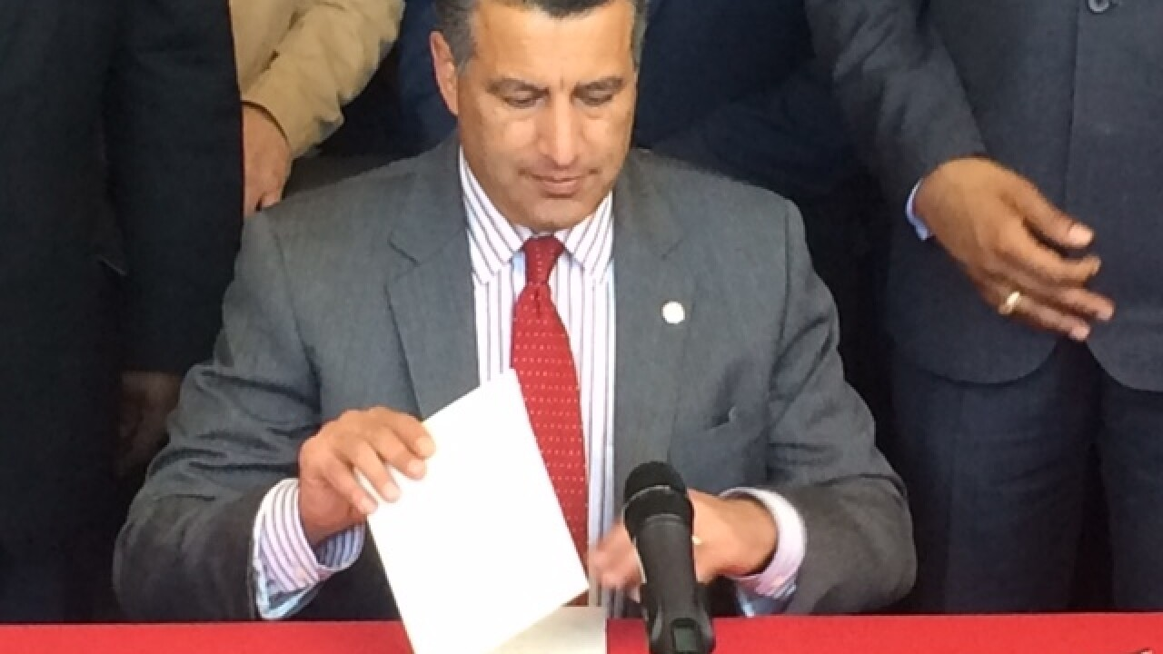 Gov. Sandoval signs education bills at UNLV