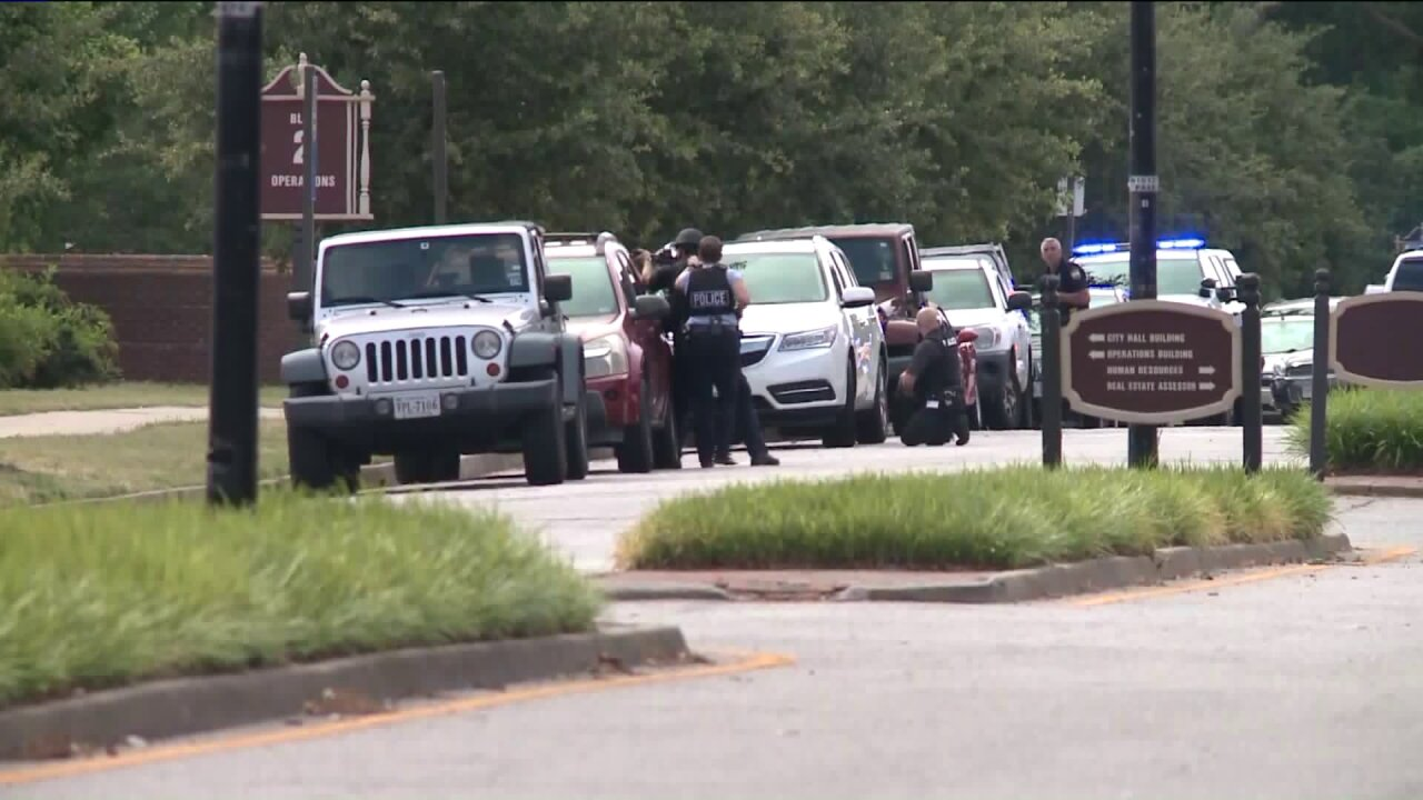 At least 12 killed, officer among 4 injured in 'devastating' shooting at Virginia Beach Municipal Center