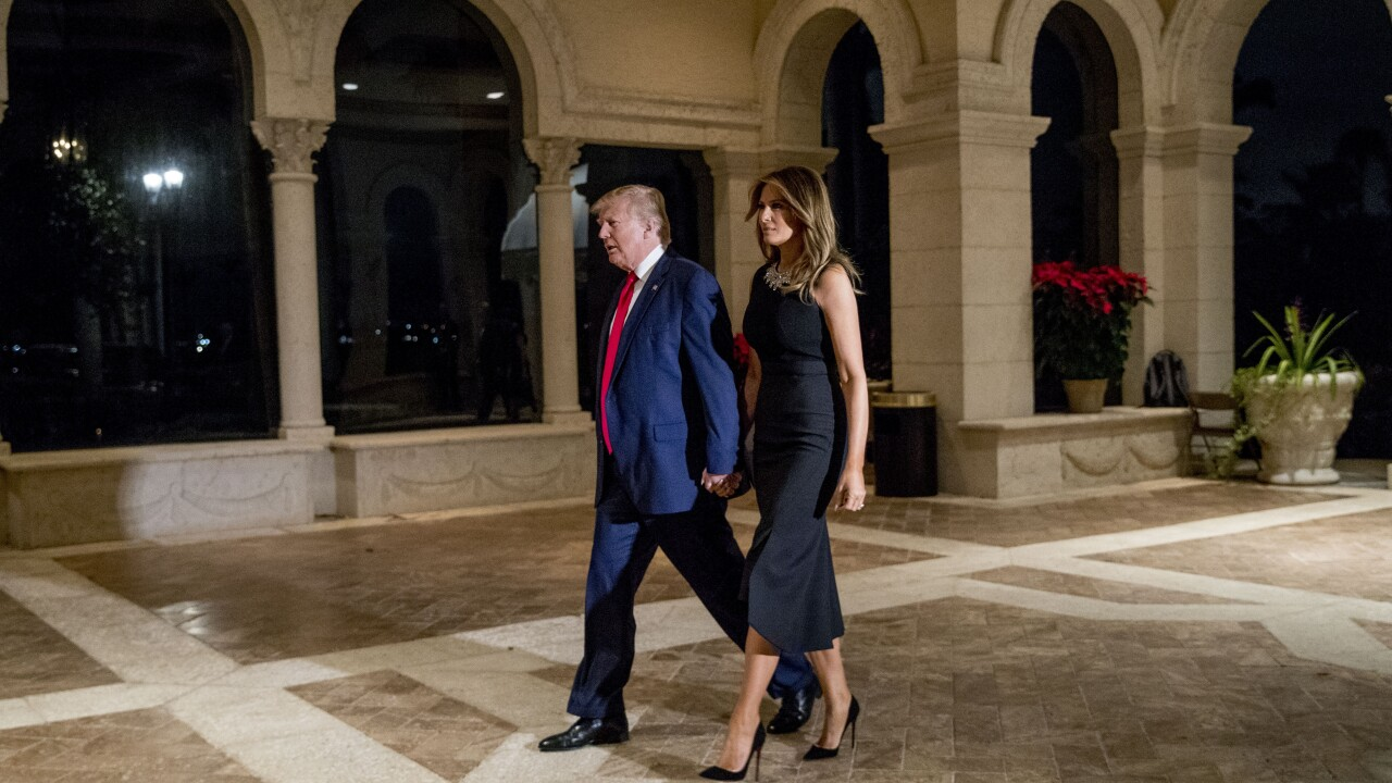 President Donald Trump and first lady Melania Trump walk to Christmas Eve dinner at Mar-a-Lago in 2019