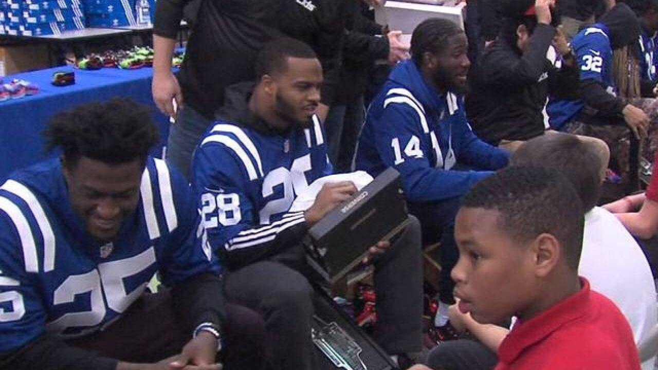 Colts   LIDS team up to put new shoes on the feet of Indy kids in need 56e8db194