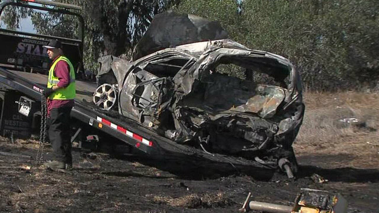 Marine rescues woman from burning car after multi-vehicle