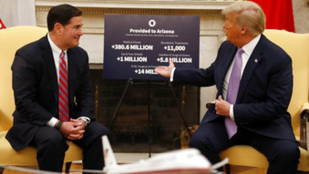 """President Donald Trump is lauding Arizona Gov. Doug Ducey, pointing to the state as a model for the nation for handling """"embers"""" of the coronavirus. Photo/AP."""