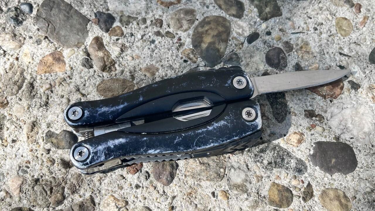 MAN BRANDISHES KNIFE 2 7-30-21.jpg