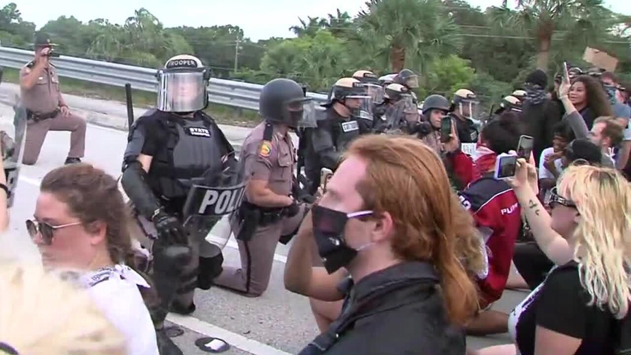 Florida Highway Patrol troopers kneel in solidarity with protesters in Boca Raton on June 1, 2020.