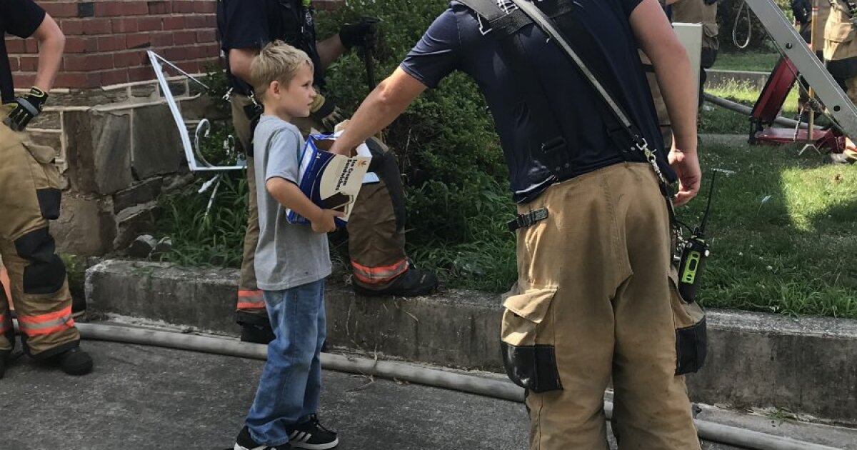 Baltimore County boy serves ice cream sandwiches to fire fighters battling fire in his neighborhood