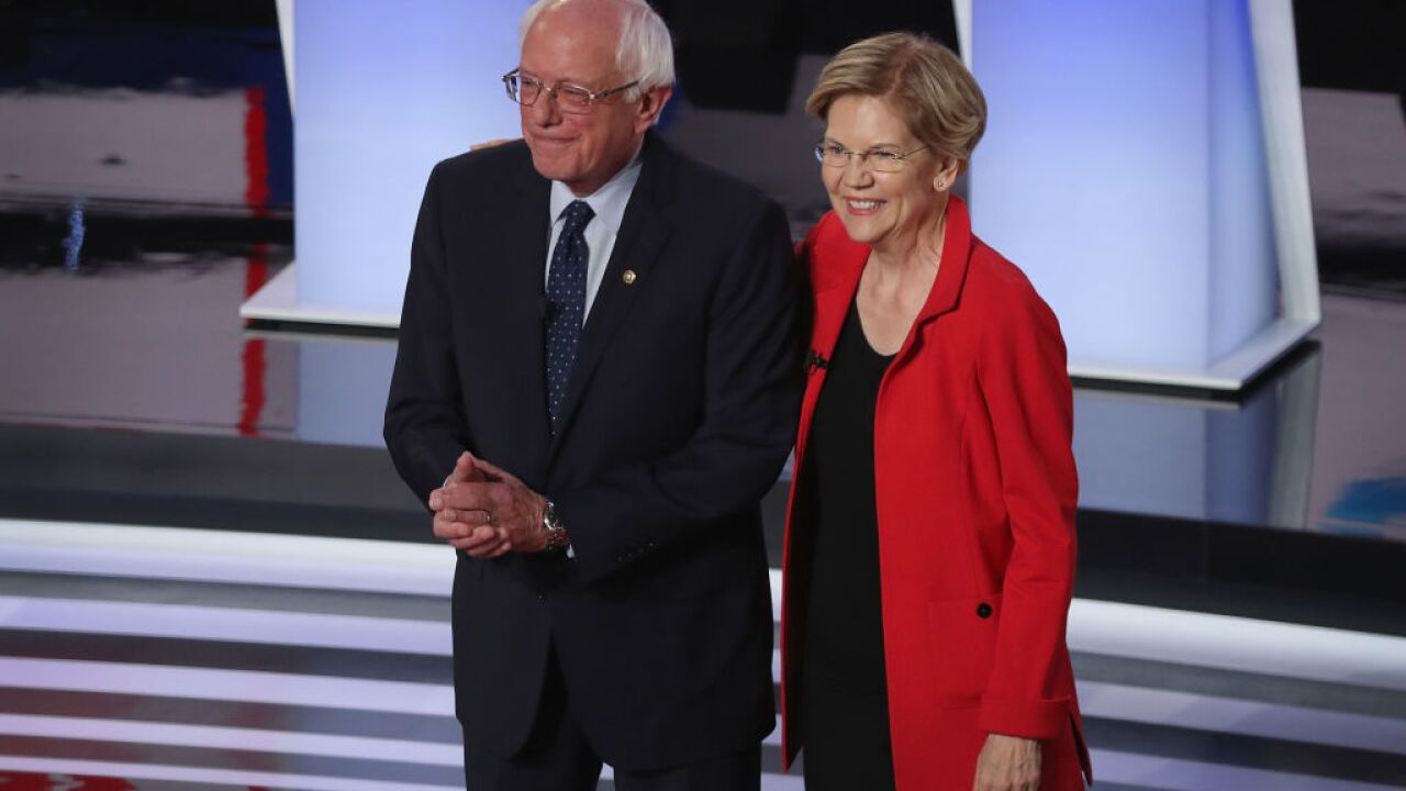 Senators Sanders and Warren defend liberal positions with moderate Democrats in debate