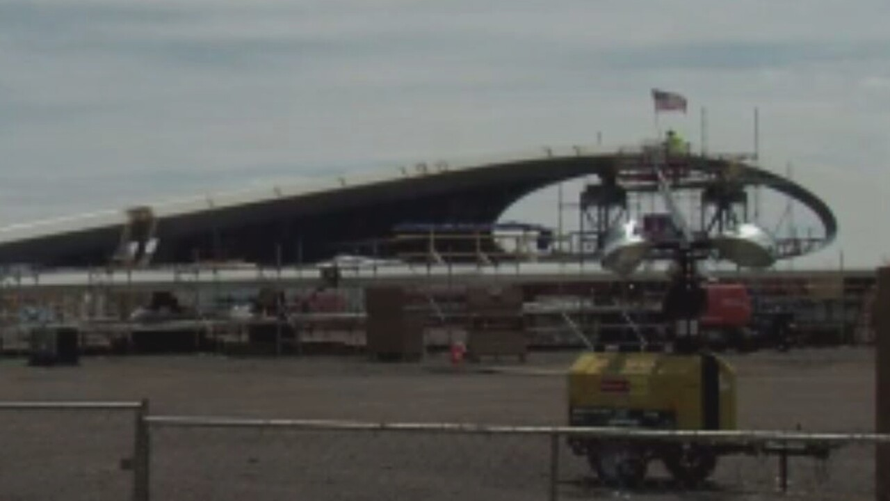 Workers continue assembly of pedestrian bridge (1).jpg
