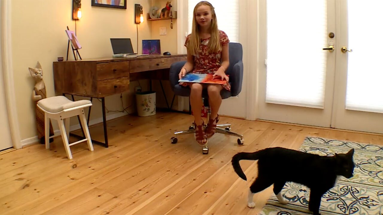 Leila Cowell, reads to animals over Zoom