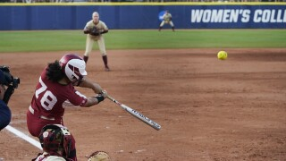 Oklahoma Sooners star Jocelyn Alo hits home run against Florida State Seminoles in sixth inning of second game of Women's College World Series championship series, June 9, 2021