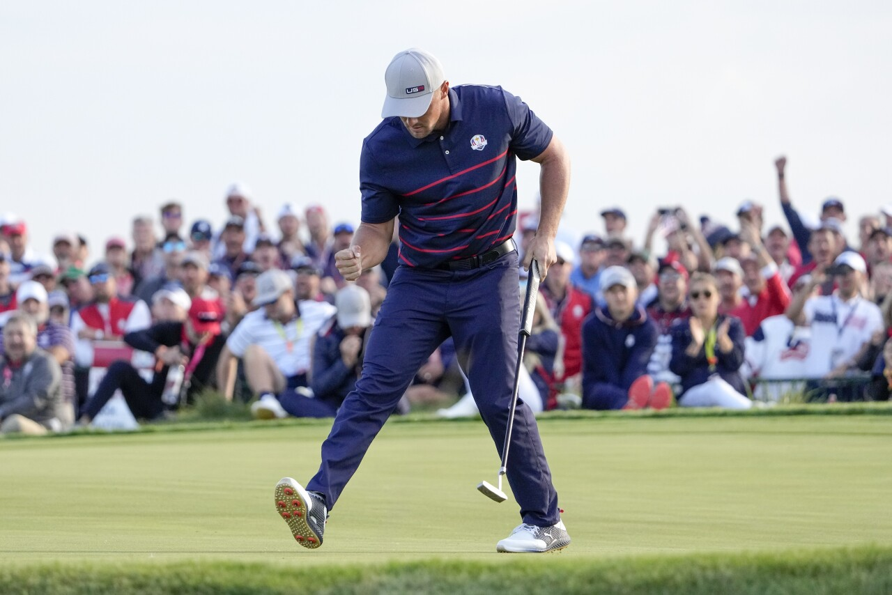 Bryson DeChambeau celebrates after putt on 15th of Ryder Cup, Sept. 24, 2021