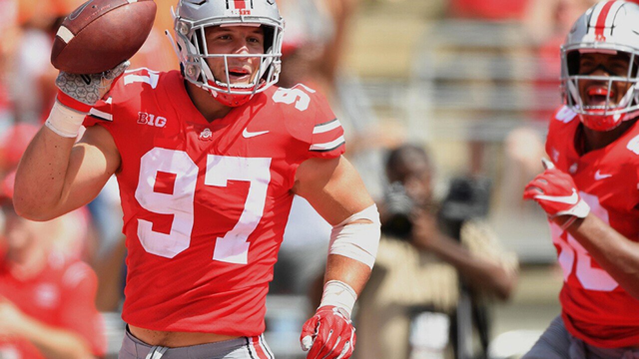 Meyer-less No. 5 Ohio State routs Oregon St 77-31 in opener