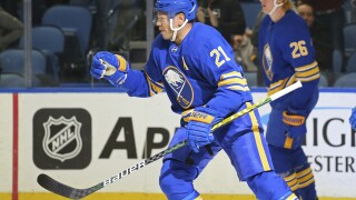 Canucks Sabres Hockey Kyle Okposo