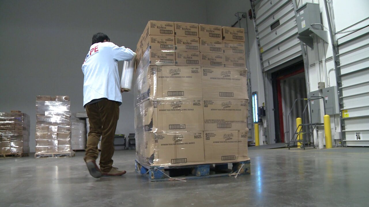 Volunteers with local nonprofit pack container full of food for refugees in MiddleEast