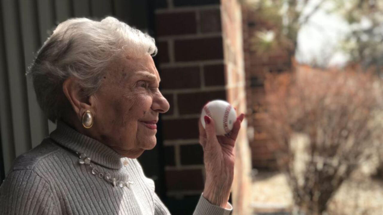 100-year-old Brewers fan holding baseball
