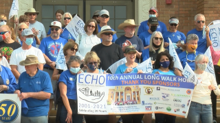Volunteers put on their walking shoes to show their support for those who are unhoused.