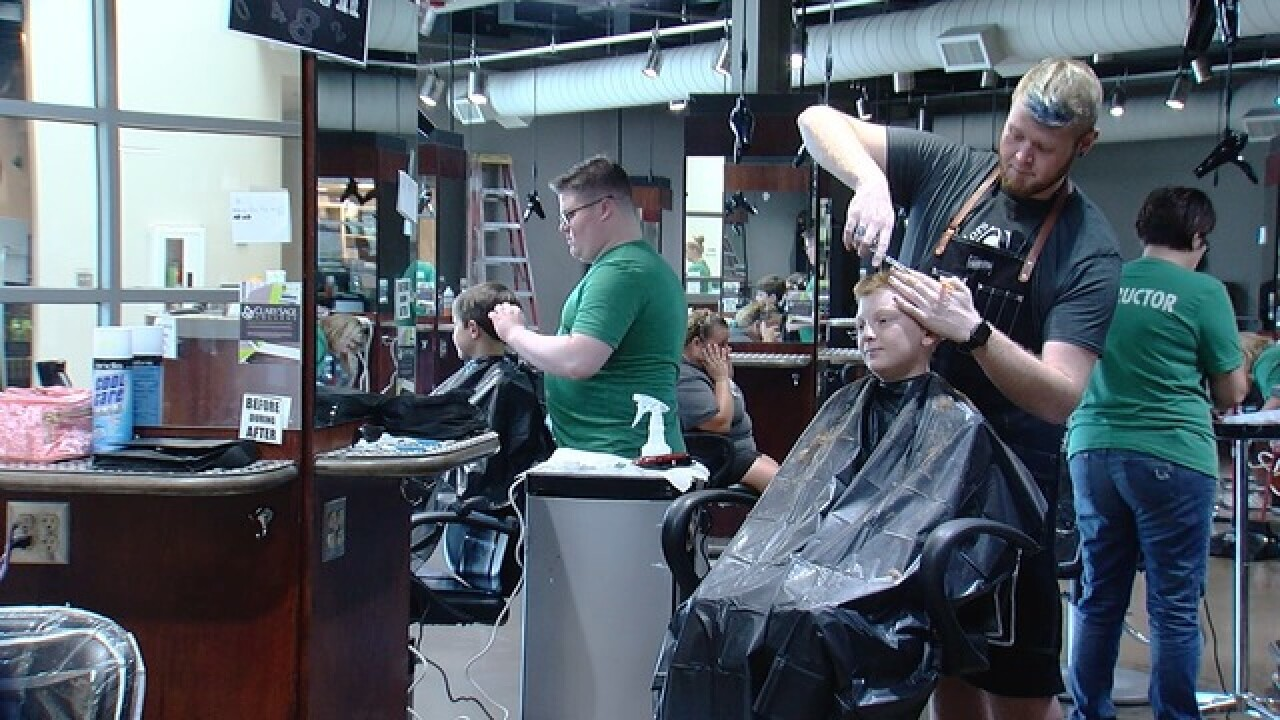 Groups offer free haircuts, supplies for school