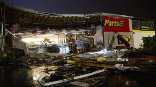 In this Tuesday, Sept. 10, 2019 photo, debris litters the ground at Advance Auto Parts following severe weather in Sioux Falls, S.D. (Abigail Dollins/The Argus Leader via AP)