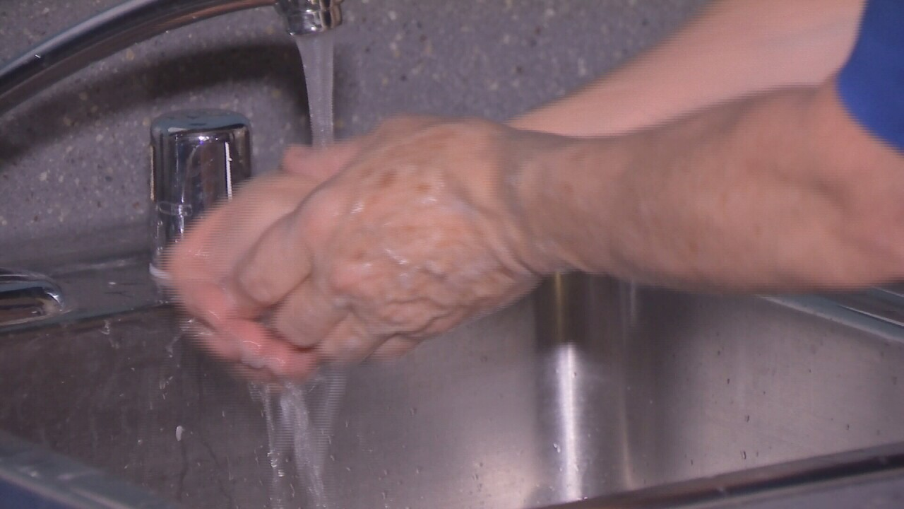 Clean hands? A Billings health expert brings out the black light to test washing technique