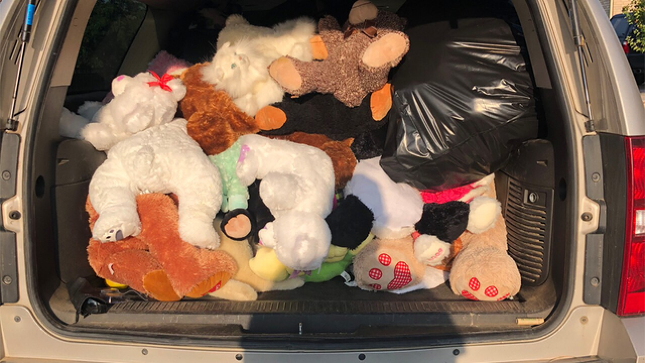 Man repurposing Watts memorial stuffed animals