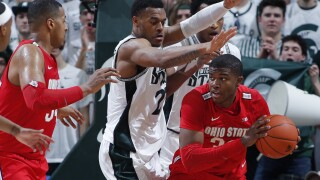 No. 16 Michigan State tops No. 19 Ohio State, shares Big Ten title