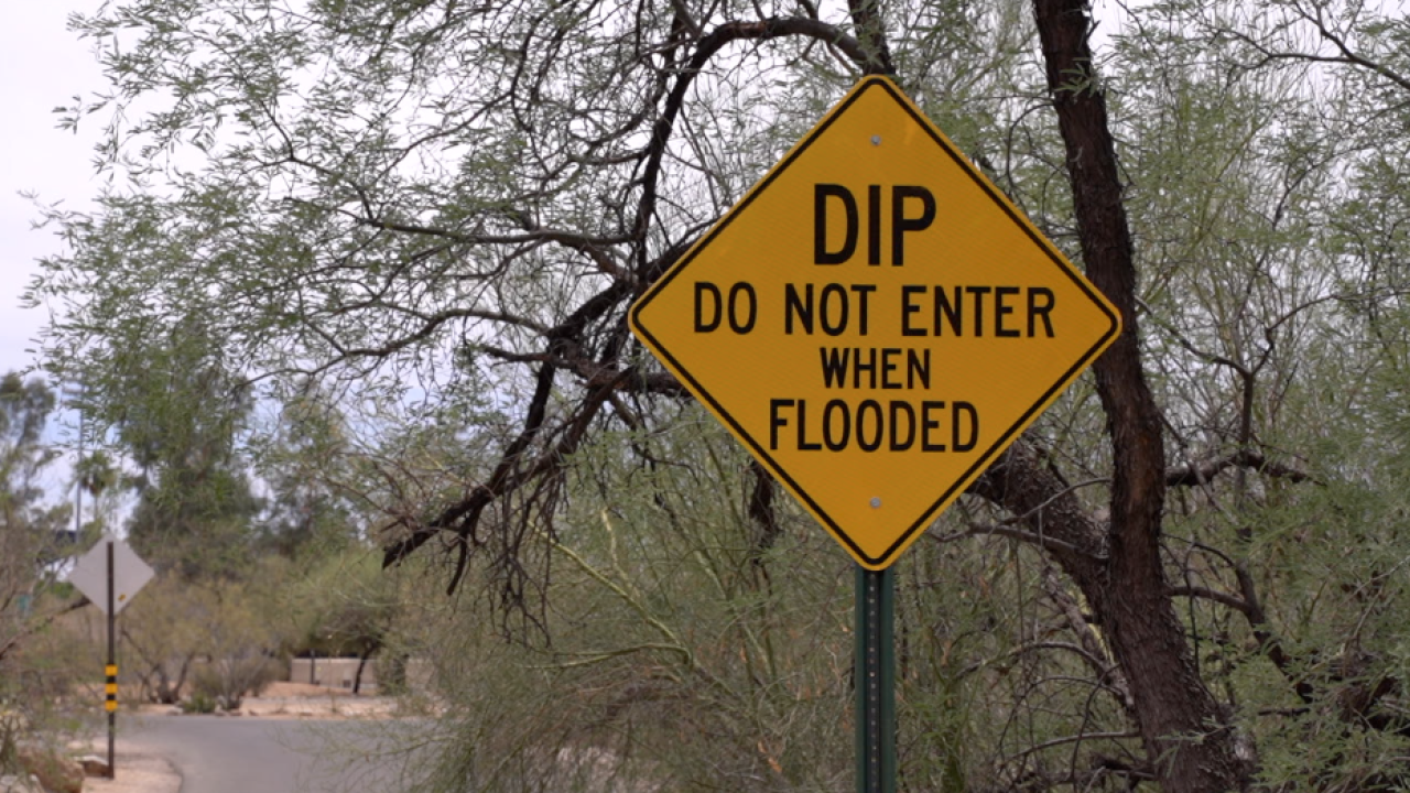 Sign saying DIP - DO NOT ENTER WHEN FLOODED