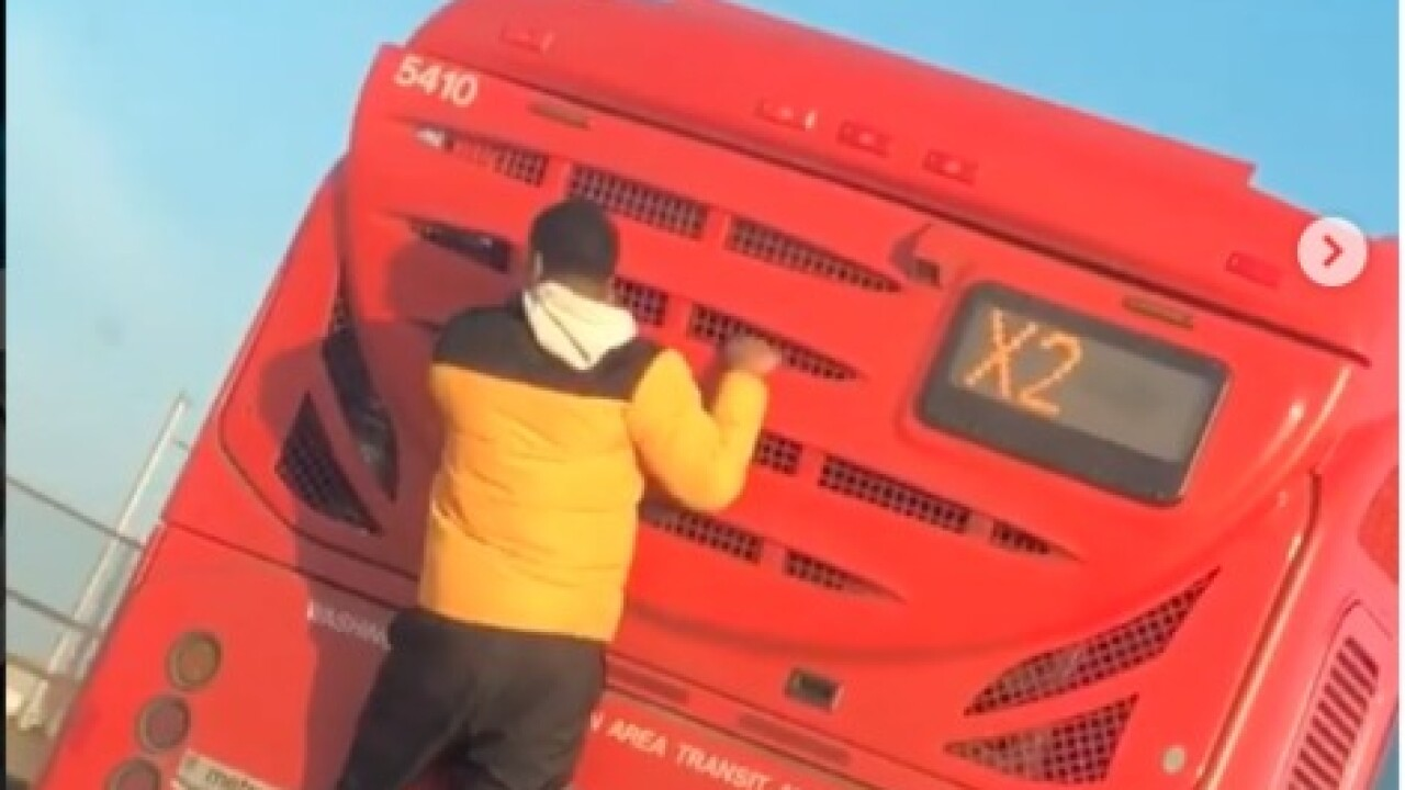 VIDEO: Man seen holding on to the back of driving D C  metro bus