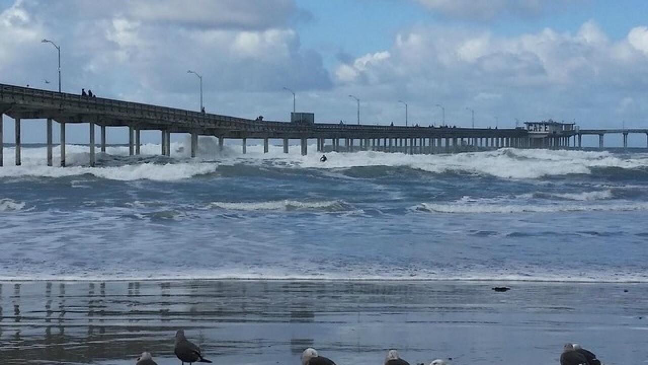 Storm blows through: Brings rain, surf, wind