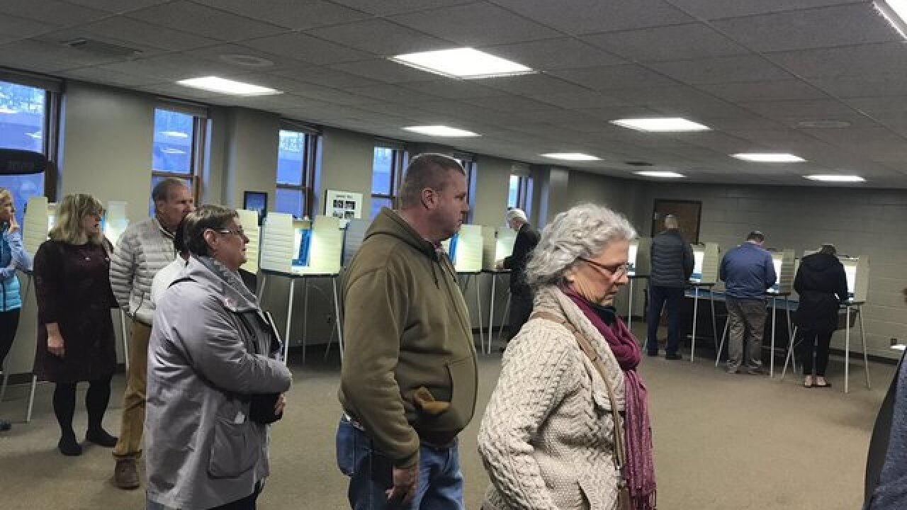 Morning voters line up to cast ballots