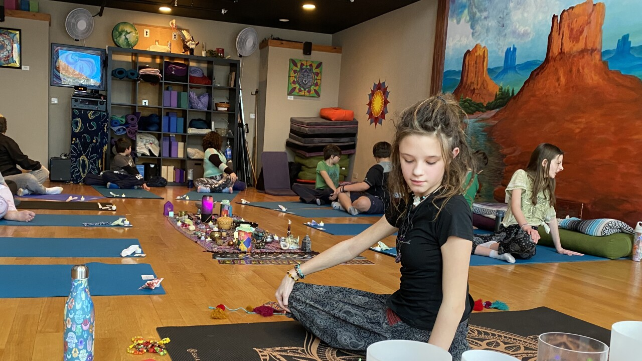 11-year-old Bhakti yoga instructor holds class