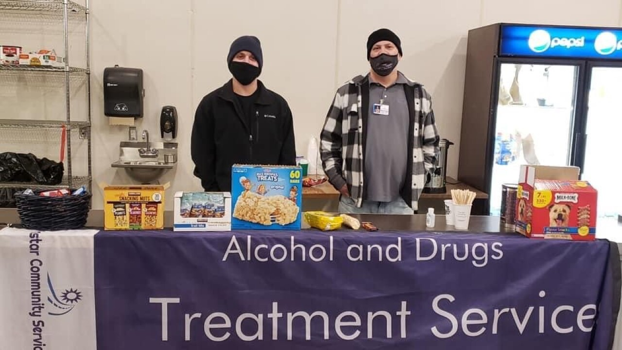 Volunteers provide snacks for COVID vaccine clinic workers