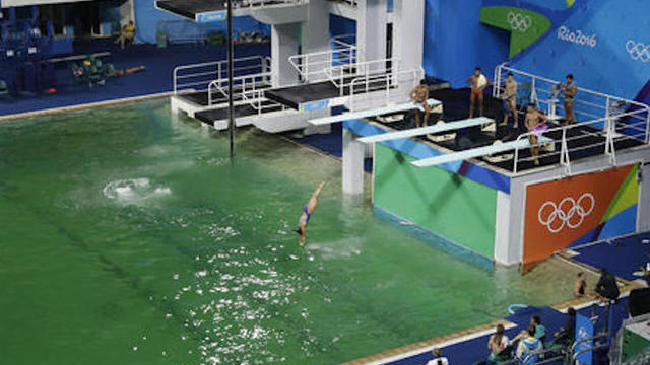 Olympic pool with green water to be drained, refilled