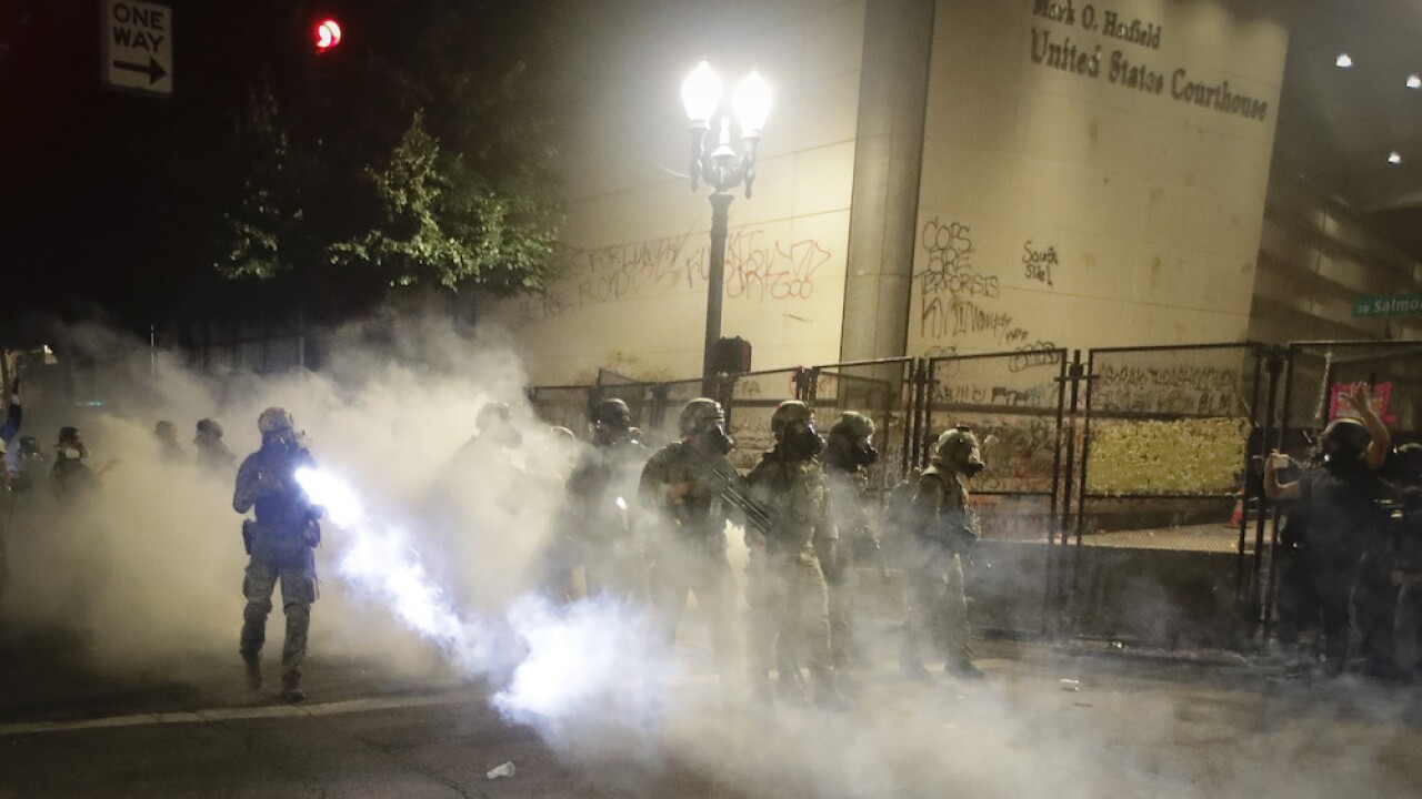 Federal agents again deploy pepper spray, flash bangs to clear protesters in Portland